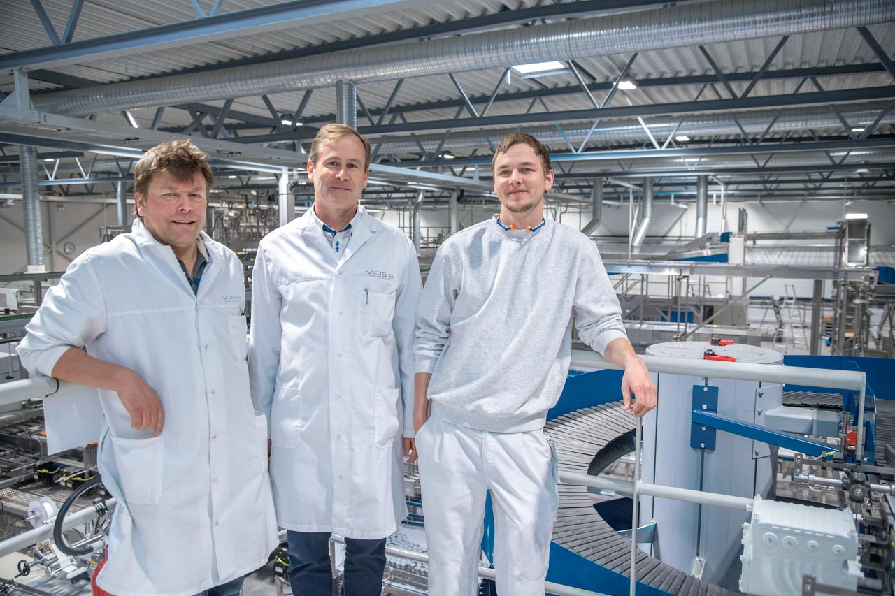 """We wanted top-class technology, and that's what we got from Krones,"" explains Olaf Grimsmo (Plant Manager, Operations Manager and Technical Manager), together with Roy Kristensen (Laboratory and Source Manager, left) and Torfinn Mykjaaland (PET Production Manager)."