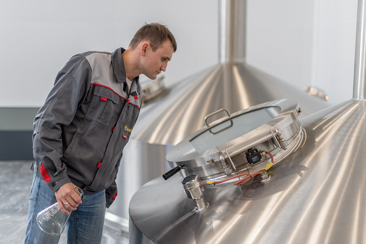 An operator monitors the mashing process.