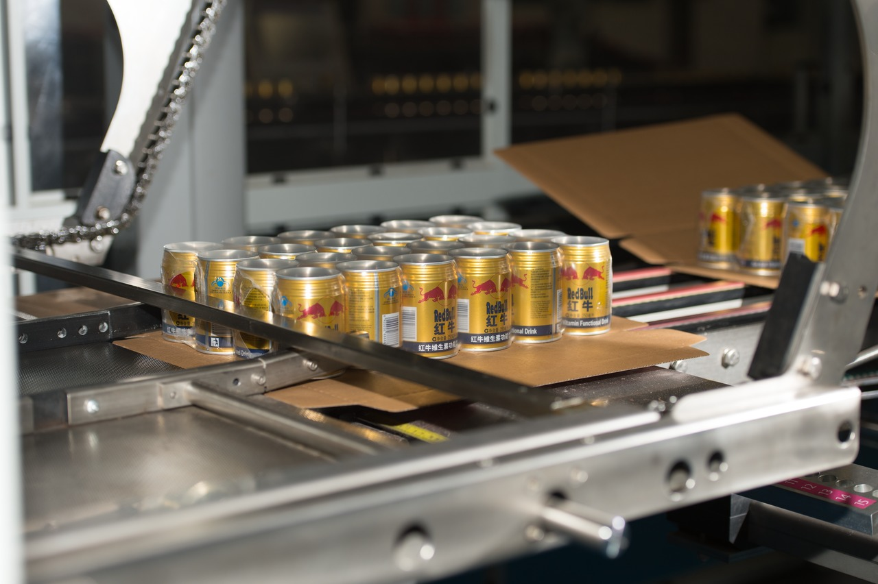 … and a Variopac Pro W3 for packing Red Bull into 24-can cartons have been installed opposite each other.