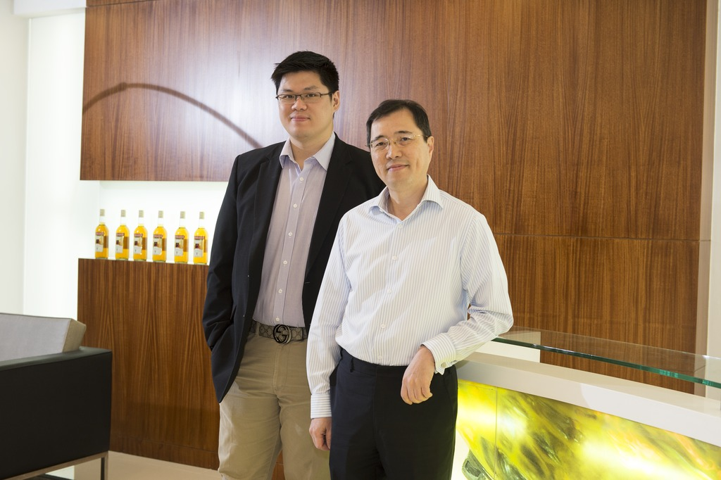"""Krones has been our partner for the company's growth in the past, and will remain so in the future"": Director Kendrick Andrew L. Tan, the son of the company's founding father (left), and Mr. Winston Co, President of Emperador Distillers Inc. (right)."
