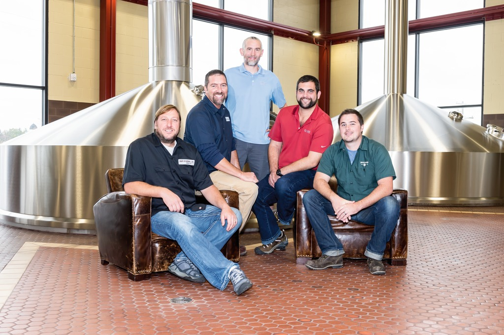 """With Krones you get what you pay for."": From the left: Brad Stevenson (Chief Production Officer), Troy Terwilligh (Fabrication and Installation Manager), Alec Mull (Vice President of Brewing Operations), Matt Sutton (Packaging Manager) and Chris Peters (Assistant Cellar Manager)"