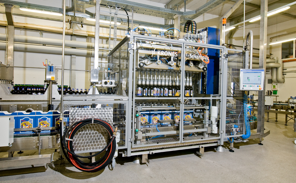 The bottles are packed in a Krones Smartpac packer using cartons erected by a Krones Variocart.