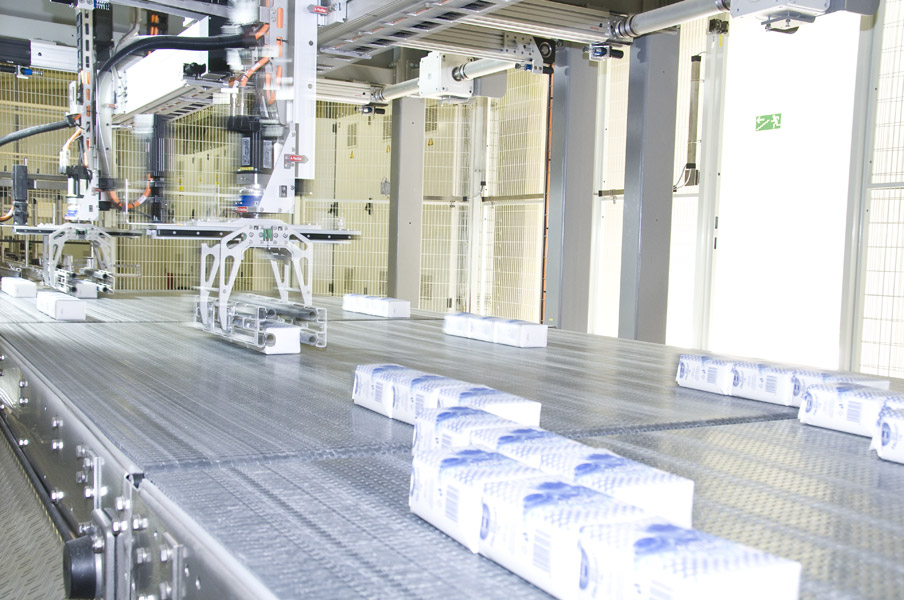 The Krones Robobox grouping unit seen orienting and positioning the sugar packets