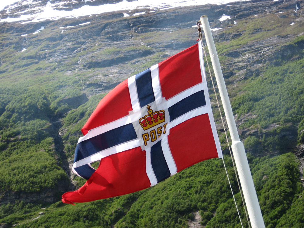 "With the Norwegian flag flying at the stern, the mail ship ""Hurtigruten"" has since 1893 been delivering goods to the country's remotest regions."